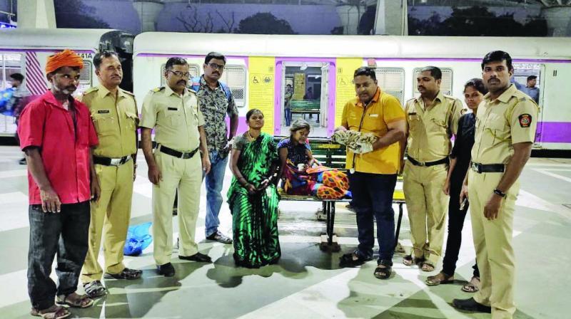 Manisha Kale and her infant at Panvel station.