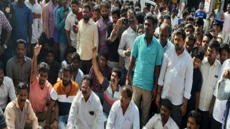 Locals on Friday staged a protest outside the Shadnagar Police Station here against the alleged rape and murder of a woman veterinary doctor on Thursday. (Photo: ANI)