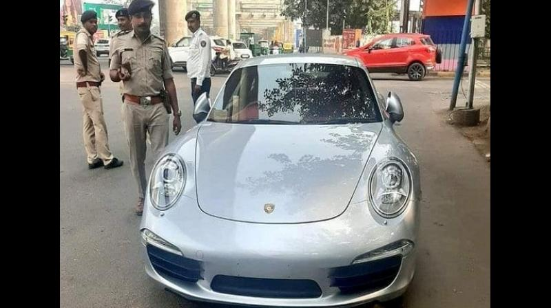 Ahmedabad police have seized a sports car Porsche 911 and the Regional Transport Office (RTO) has fined its owner with Rs 9.80 lakhs for not having a number plate and other valid documents. (Photo: ANI)