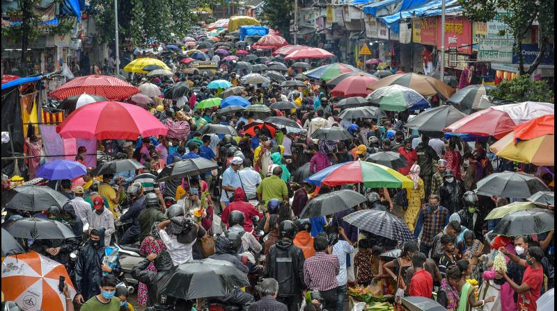 People, violating social distancing norms, step out for shopping on the eve of Ganesha Chaturthi festival, at Dadar market in Mumbai. — PTI photo