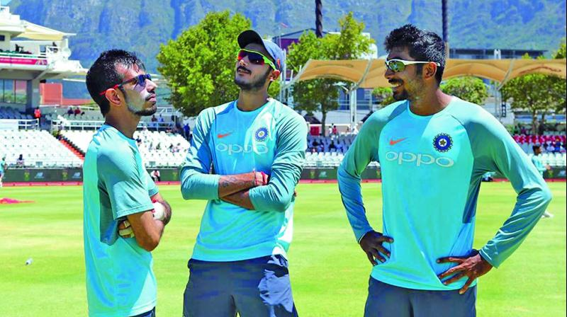 Yuzvendra Chahal (left), Axar Patel (centre) and Jasprit Bumrah.