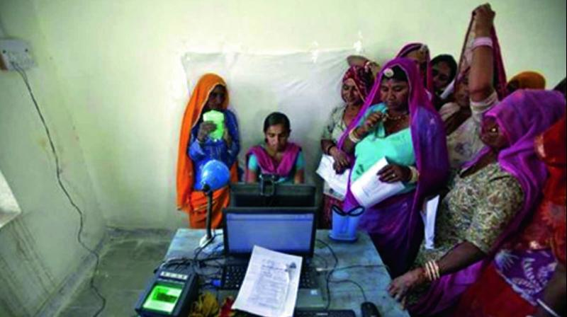 A file photo of women queuing up to apply for the Aadhaar card in Merta town of Rajasthan.