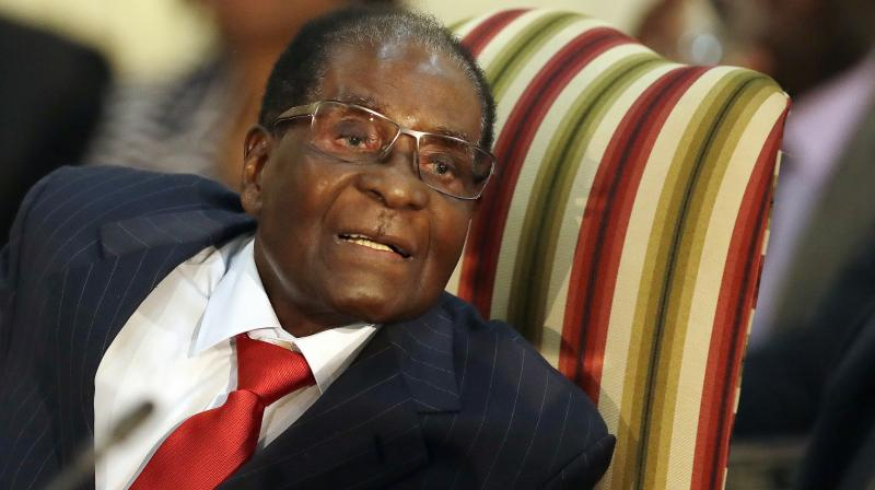 Mugabe's advanced age, poor health and listless public performances have fuelled a bitter succession battle between his wife Grace and former vice president Emmerson Mnangagwa. (Photo: AP)