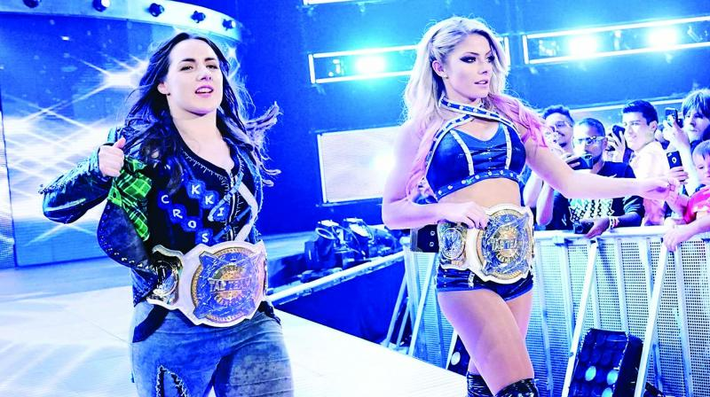 Nikki Cross and Alexa Bliss head to the ring for the Women's Tag Team title match against Asuka & Kairi Sane during WWE's Monday Night Raw at the Scotiabank Arena in Toronto. (Photo: WWE.com)