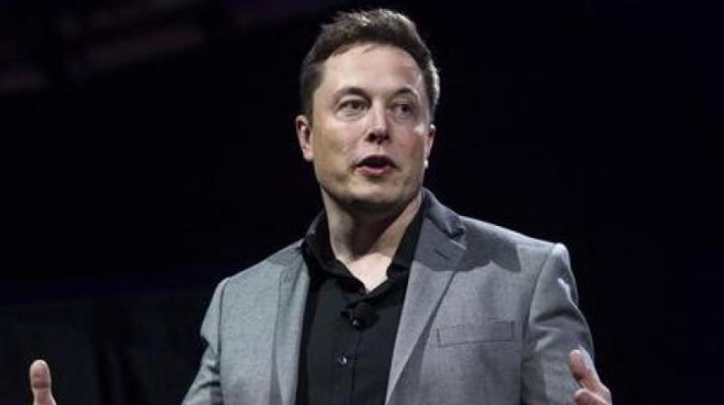 In September, Musk provoked a Twitter storm by smoking pot, drinking whiskey and wielding a sword on a live web show with comedian Joe Rogan. (Photo: AP)
