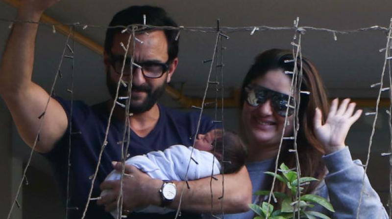 Saif, Kareena and Taimur at their residence.