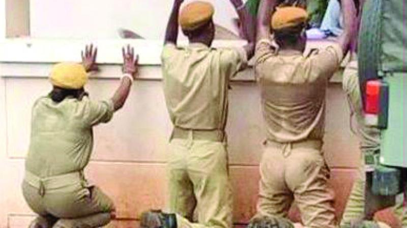 A picture that went viral on social media shows four homeguards kneeling down in front of the  district office at Baripada in Odisha.