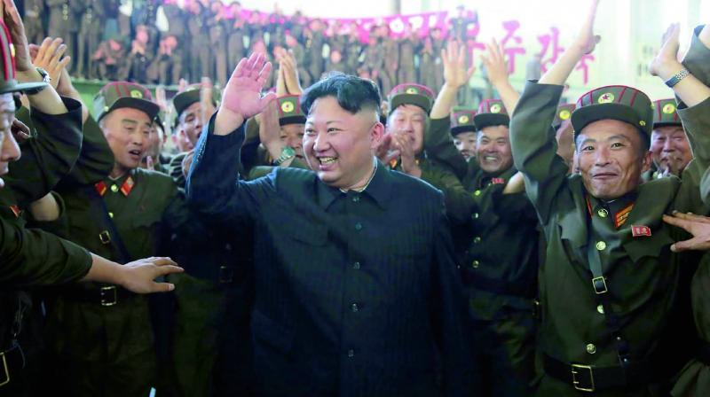 North Korean leader Kim Jong-Un celebrates the  successful test-fire of the intercontinental ballistic  missile Hwasong-14 at an undisclosed location. (Photo: AFP)