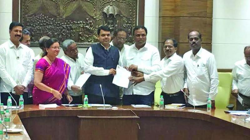 Chief minister Devendra Fadnavis (c) with members of the coordination committee and senior members.