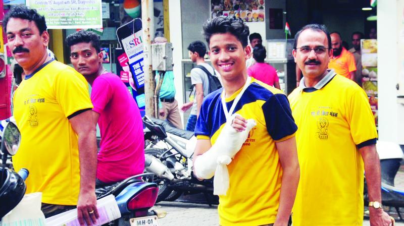 Youth smiles despite injury outside KEM hosp.
