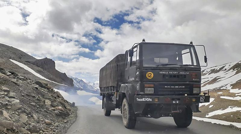 An Indian army vehicle moves towards Ladakh, amid India-China border dispute in eastern Ladakh, at Bara-lacha la mountain pass in Lahual district. PTI Photo