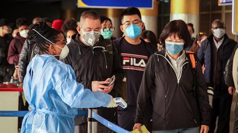 Passengers arriving from Changsha in China are screened for the new type of coronavirus (Patrick Ngugi/ AP)