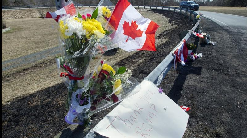 A memorial pays tribute to Royal Canadian Mounted Police Constable Heidi Stevenson, a mother of two and a 23-year veteran of the force, along the highway in Shubenacadie, Nova Scotia. (AP Photo)