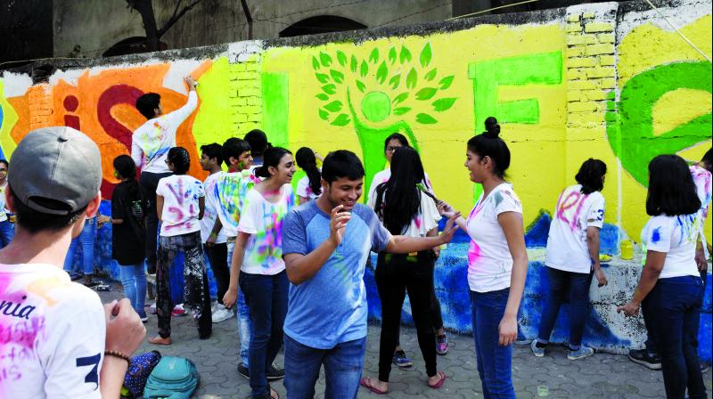Students in action at Worli wall