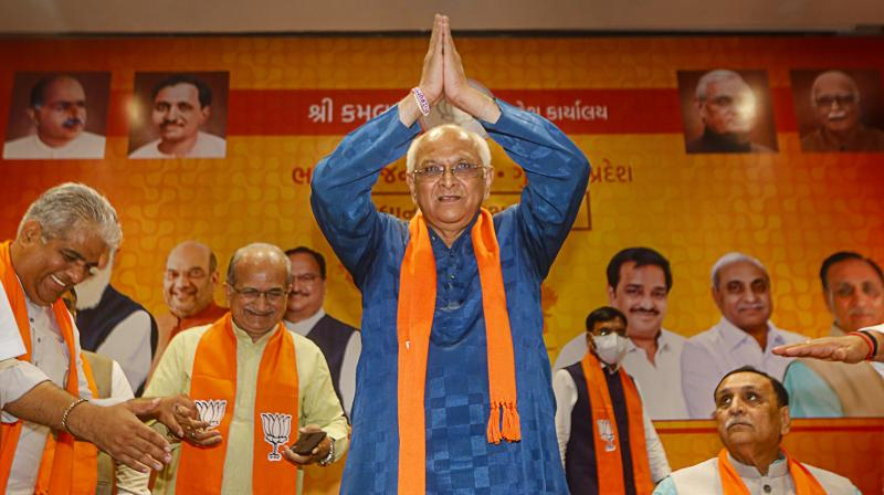 BJP leader Bhupendra Patel acknowledges the greeting after being appointed as new Gujarat Chief Minister, at party headquarters in Gandhinagar, Sunday. (Photo: PTI)