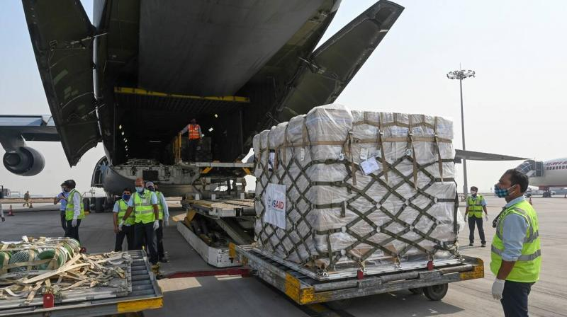 Relief supplies from the United States in the wake of India's COVID-19 situation arrive at the Indira Gandhi International Airport cargo terminal in New Delhi, India, Friday, April 30, 2021. (Photo: AP)