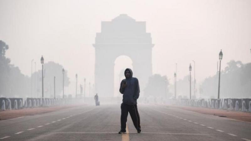 A man walks along the Rajpath street near India Gate amid smoggy conditions a day after Diwali in New Delhi on November 15, 2020. (Photo: AFP/File)