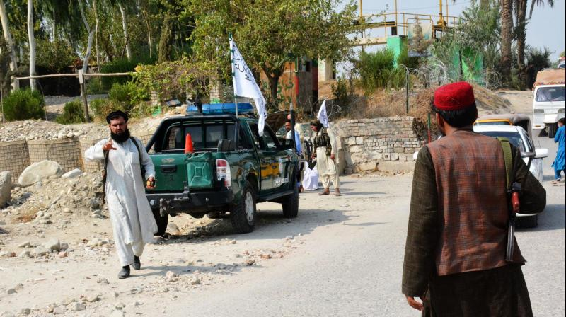Taliban members inspect near the site of a blast in Jalalabad. (Photo: AFP)
