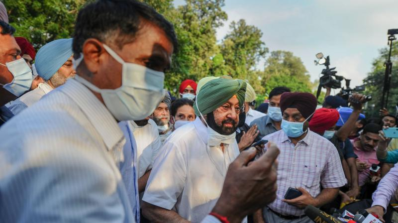 Captain Amarinder Singh speaks to media after submitting his resignation to Governor Purohit Banwarilal at Raj Bhavan in Chandigarh. (Photo: PTI)