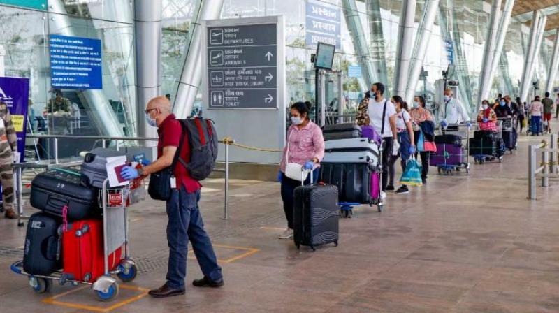 Passengers enter the Delhi International Airport. (Photo: PTI/File)