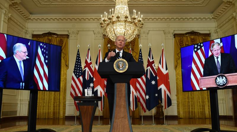 US President Joe Biden participates is a virtual press conference on national security with British Prime Minister Boris Johnson (R) and Australian Prime Minister Scott Morrison in the East Room of the White House. (Photo: AFP)