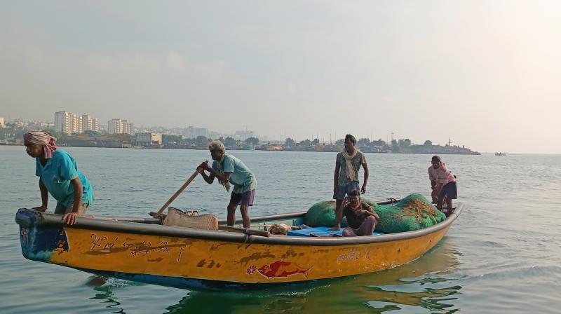 Fishermen returning back to the coast in Visakhapatnam. (Photo: V.Kamalakara Rao/DC)