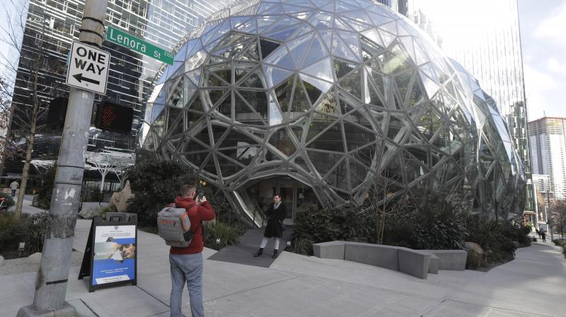 The Amazon headquarters sits virtually empty on March 10, 2020 in downtown Seattle, Washington. In response to the coronavirus outbreak, Amazon recommended all employees in its Seattle office to work from home, leaving much of downtown nearly void of people. The Amazon Spheres conservatory, located on the Amazon campus, serves as an employee lounge and workspace. (AFP)