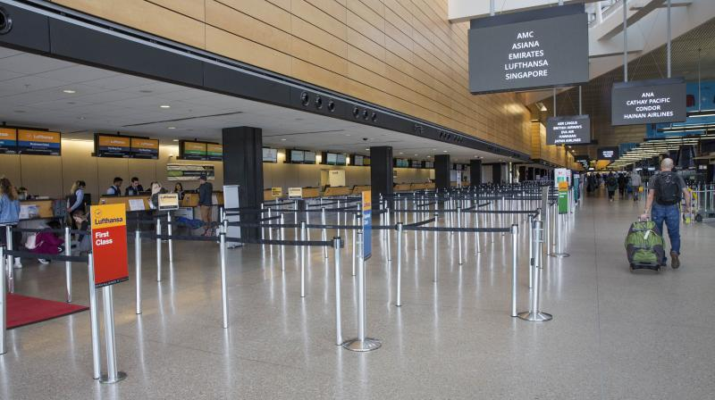 Check-in gates are quiet at SeattleTacoma International Airport  due to travel restrictions worldwide on account of the coronavirus scare. (AFP)is seeing a global slowdown as a result of fears over the novel coronavirus, COVID-19.