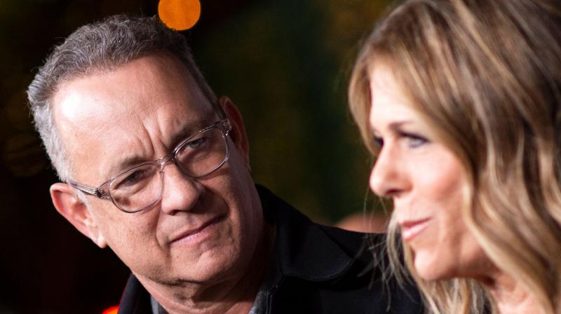 File photo of Tom Hanks (left) and his wife Rita Wilson attending a function in Los Angeles on November 7, 2018. Tom Hanks and his wife Rita Wilson have both tested positive for coronavirus, the US actor said Wednesday. Hanks, 63, said he and Wilson came down with a fever while in Australia, and will now be isolated and monitored. (AFP)