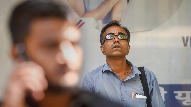 A man watches the screen outside BSE building as the Sensex nosedives. (PTI)