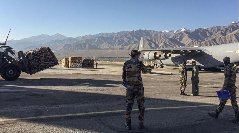 An IAF transport aircraft C17 brings in essentials supplies at a base in Ladakh. — PTI photo