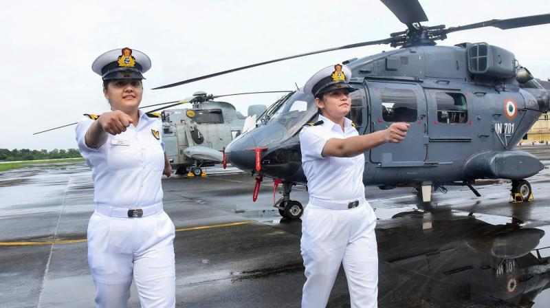 Sub Lt Riti Singh and Sub Lt. Kumudini Tyagi, the first women airborne tacticians who will operate from deck of warships passed out of Indian Navy's observer Course, at Southern Naval Command, Kochi in Kerala. — PTI photo