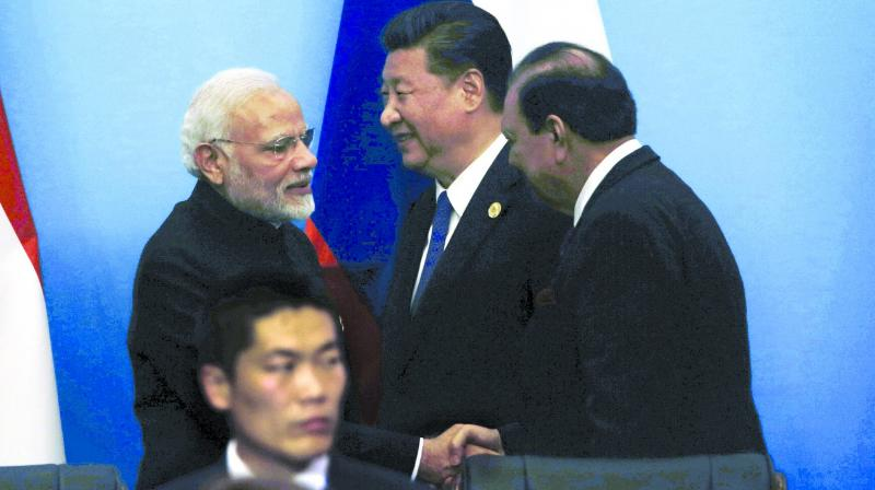 Prime Minister Narendra Modi shakes hands with Pakistan President Mamnoon Hussain after a joint press conference for the SCO Summit in Qingdao, China. (Photo: AP)