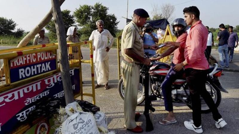 Security personnel keeping strict vigil near Sunaria Jail in which Dera Sacha Sauda Chief Ram Rahim's quamtum of punishment will be awarded in Rohtak on Monday. (Photo: PTI)
