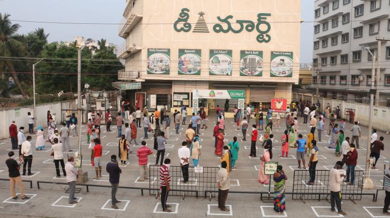 People maintain social distance as they wait outside a shopping mall at Madhurawada as the whole nation goes lockdown to combat the spread of COVID-19 in Visakhapatnam on Monday. (DC Photo: Murali Krishna)