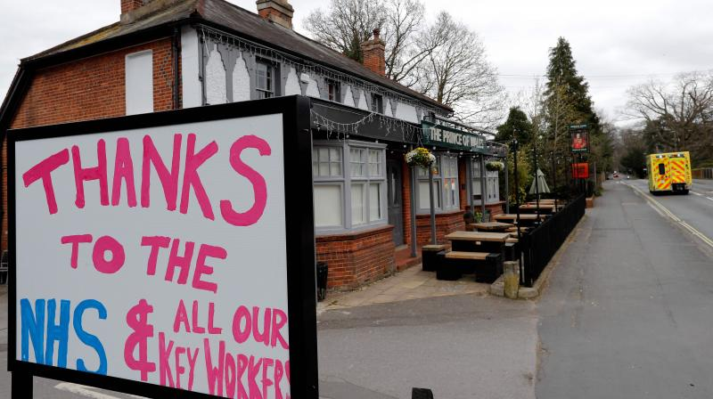The closed-down Prince of Wales pub in southwest London displays a sign thanking the National Health Service. (AFP)