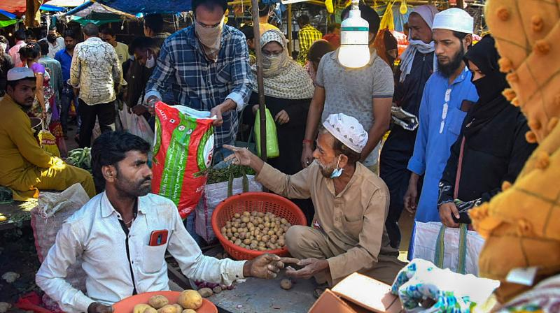 Social distancing thrown to the winds as people of Bhopal purchase vegetables during the open window available to them each day under the 21-day nationwide lockdown imposed to contain the coronavirus. (PTI)