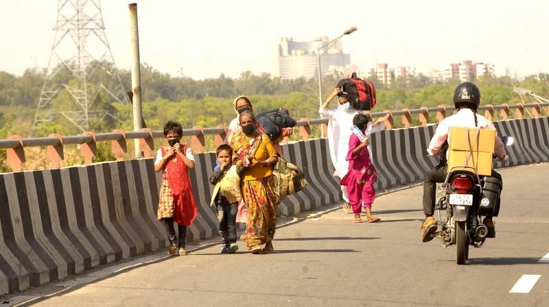 Migrant workers make the journey to their respective villages on foot following the nationwide lockdown amid the coronavirus epidemic in New Delhi. (DC Photo: Pritam Bandyopadhyay)