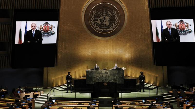 Bulgaria's President Rumen Radev is seen on video screens as he addresses the 76th Session of the United Nations General Assembly remotely, Sept. 21, 2021 at U.N. headquarters. (Spencer Platt/Pool Photo via AP)