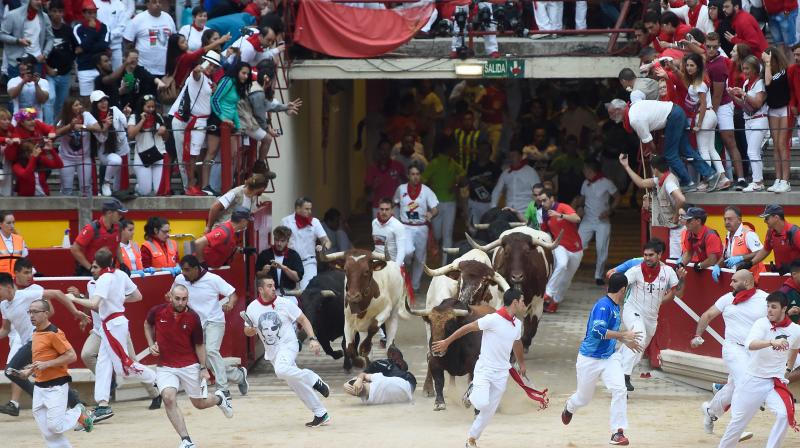 Revellers from around the world flock to Pamplona every year to take part in the eight days of the running of the bulls. (Photo:AFP)