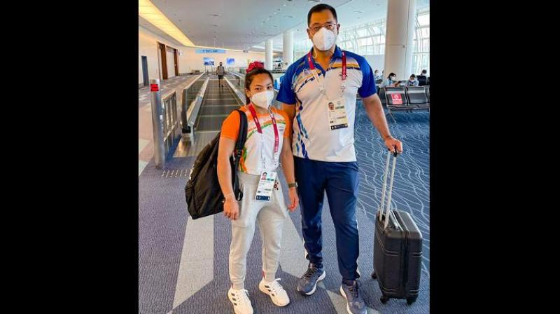 Olympic silver medalist Mirabai Chanu before her flight to India, in Tokyo. -- PTI