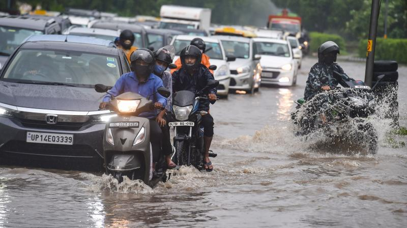 Vehicles ply on the waterlogged Ring Road during monsoon rains, in New Delhi, Tuesday, July, 27, 2021. (PTI/Atul Yadav)