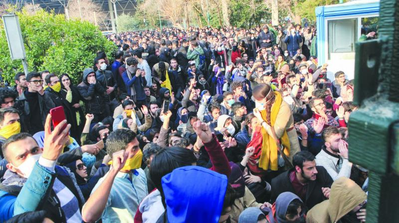 Students attend a protest inside the Tehran University. (Photo: AP)