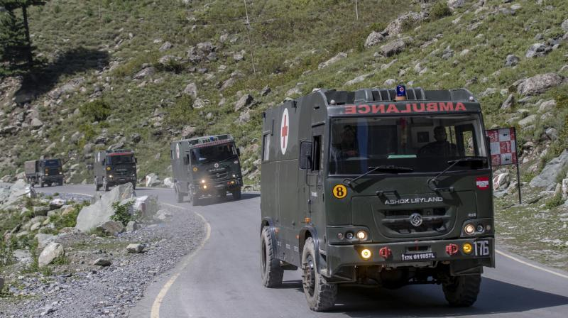 Ambulances belonging to Indian army moves along with the army convoy on the Srinagar-Ladakh highway at Gagangeer, northeast of Srinagar. PTI Photo