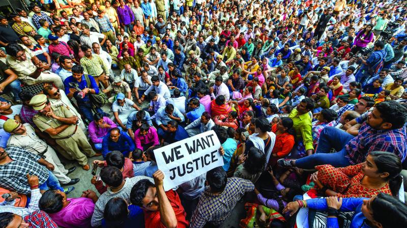 Police personnel gather outside the police headquater at  ITO during a protest against the alleged repeated incidents of alleged violence against them by lawyers in New Delhi. on Tuesday. (Photo: PTI)