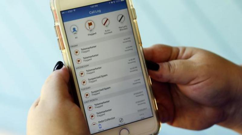 The new rules make clear that they can block additional calls that are likely scams, such as numbers that start with a 911 area code, or one that isn't currently assigned to anyone. (Photo: AP)