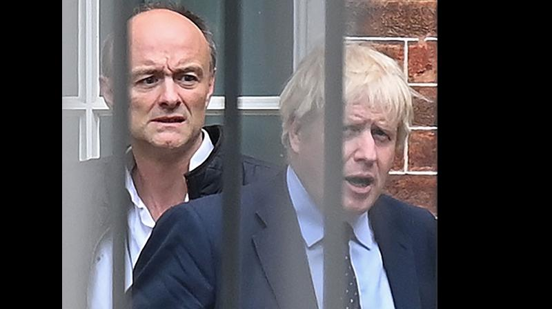 In this file photo taken on September 03, 2019 Britain's Prime Minister Boris Johnson (R) and his special advisor Dominic Cummings leave from the rear of Downing Street in central London on September 3, 2019, before heading to the Houses of Parliament.AFP Photo