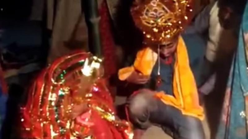 Video clips from the wedding show Vinod Kumar, the forced groom, being thrashed and compelled to perform wedding rituals in Patna's Pandarak area. (Screengrab)