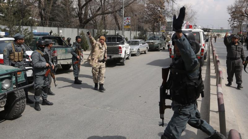 Security forces inspect the site of attack in Kabul, Afghanistan. (Photo: AP)