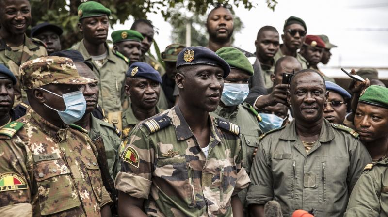 Colonel-Major Ismael Wague, center, spokesman for the soldiers identifying themselves as the National Committee for the Salvation of the People, holds a press conference at Camp Soudiata in Kati, Mali. (AP)